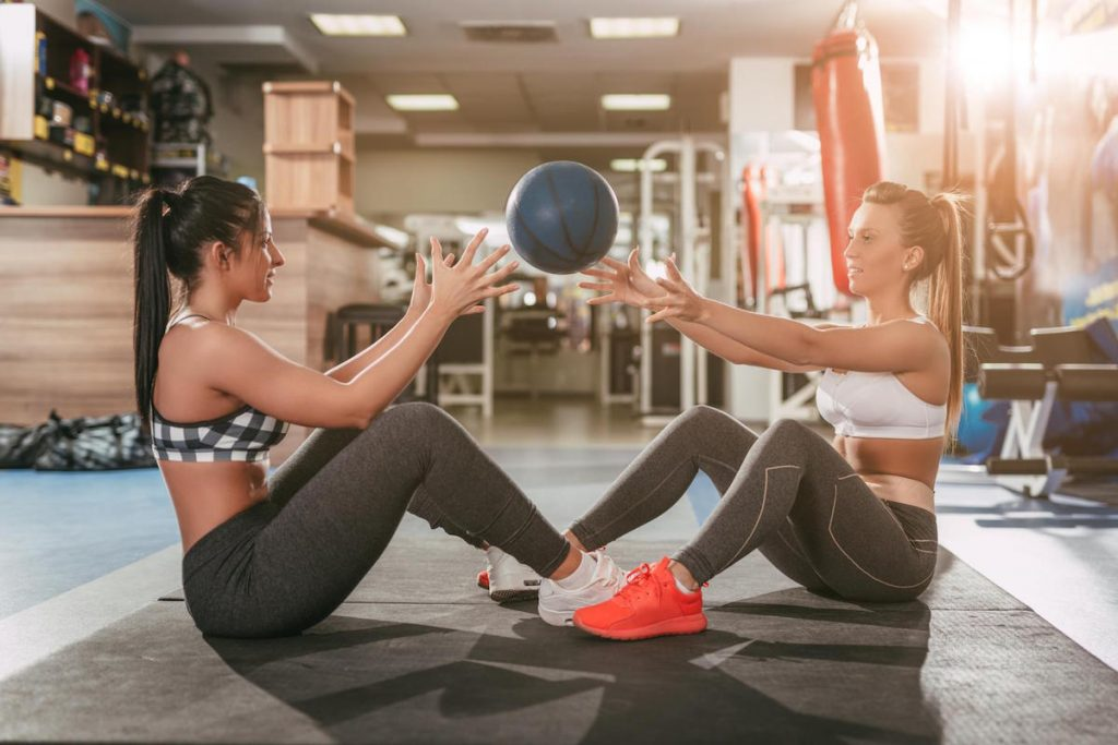 Two Girl Exercising At The Gym